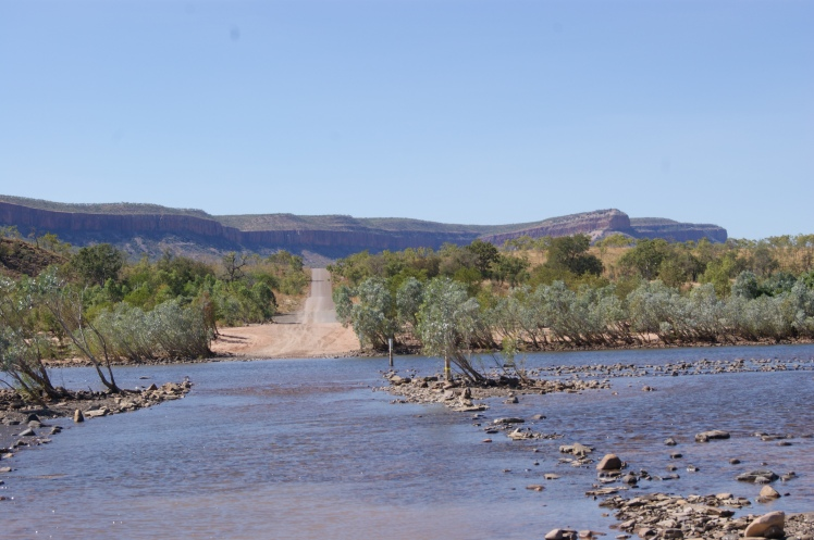 Crossing the pentecost river, ranges in the background